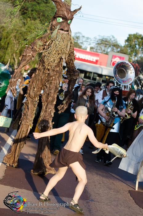 2013 Parade shot of the very tall Ent faced by Gollum with a Fish